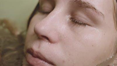 Woman Closing Eyes Underwater In Bath