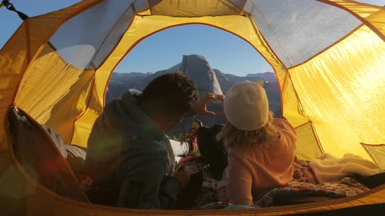 Thumbnail for A Hand Heart Made By a Couple, Relaxing in a Tent, Against the View of Half Dome Mountain. Yosemite.