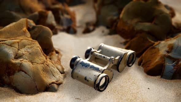 Thumbnail for Old German Military Binoculars on the Sand Beach