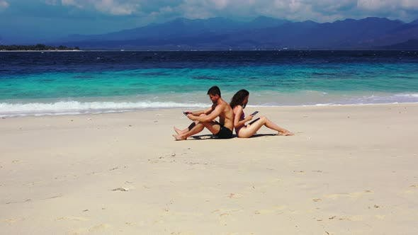 Romantic couple in love dating on vacation spend quality time on beach on paradise white sand 4K bac