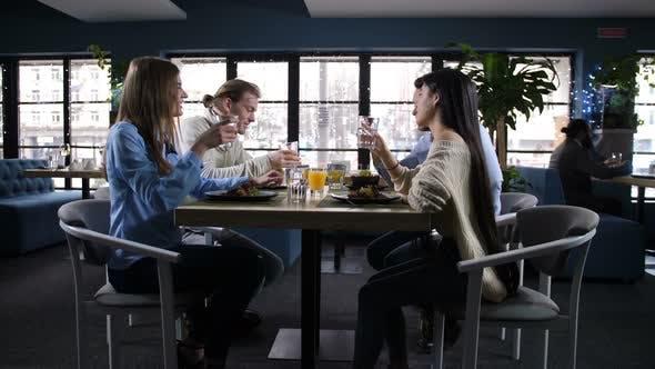 Cover Image for Joyful Friends Spending Time in Cozy Restaurant