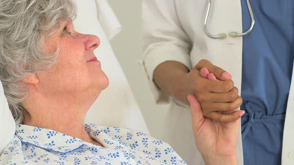 Thumbnail for Caucasian patient holding her doctor's hand