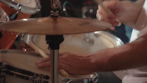 Drummer Plays Percussion Instruments at a Concert