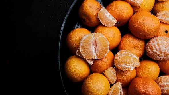 Thumbnail for Juicy and Ripe Tangerines on a Dark Background