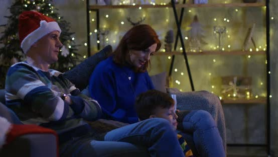 Thumbnail for Family Watching Television at Christmas Eve