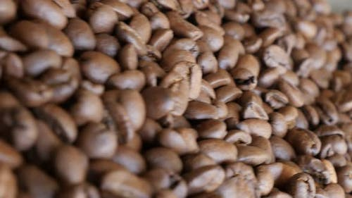 High quality Arabica coffe beans on table filmed with dolly slider 4K 2160p 30fps UltraHD video - Ar