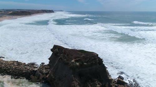 High Waves Breaking on the Rocks of the Coastline