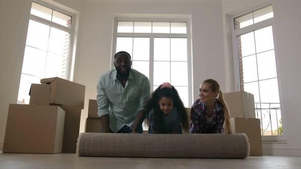 Thumbnail for Joyful Family Rolling Carpet on Floor in New House