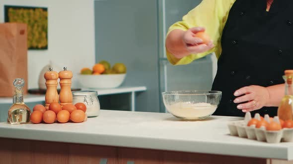 Cracking Eggs on Glass Bowl