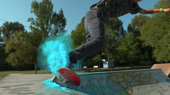 Skateboarding through blue dust, Ultra Slow Motion