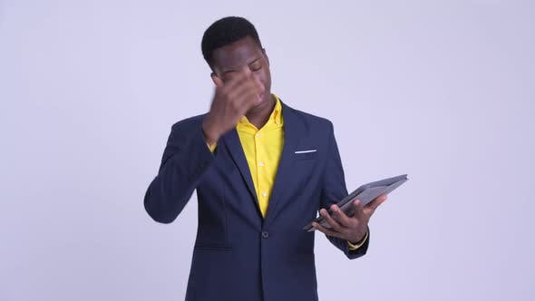 Thumbnail for Young Stressed African Businessman Using Digital Tablet and Getting Bad News