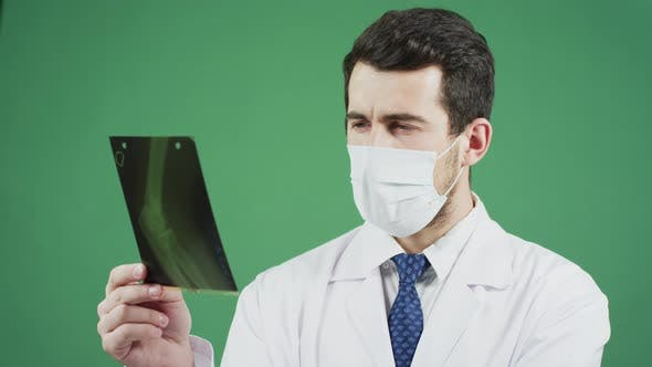 Thumbnail for Doctor analyzing an x-ray