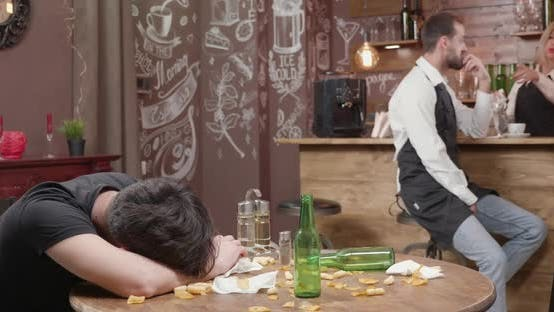 Young Bartender Tries To Wake a Drunk Customer