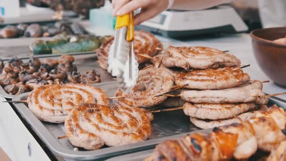 Thumbnail for Ready-to-Eat Grilled Meat in a Street Food Shop Window. Ready-made Food on Party