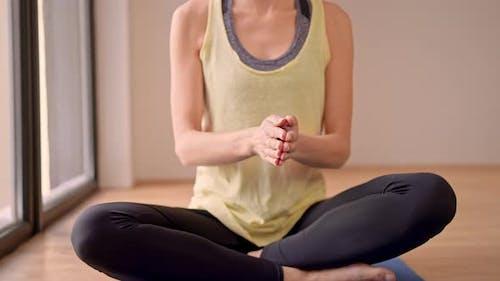 Female in Sportswear Meditate in Flat