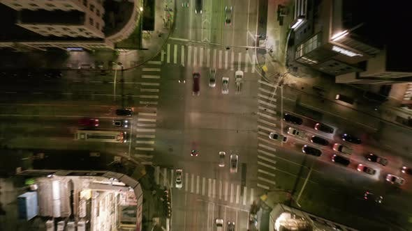 Thumbnail for AERIAL HYPER LAPSE: Road Intersection at Night with Car Traffic and Lights []