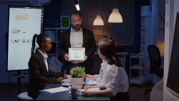 Focused Workaholic Entrepreneur Man Working Overtime Presenting Company Statistics