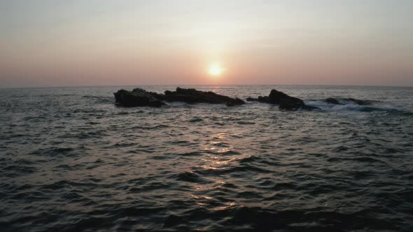 Thumbnail for Aerial View of the Ocean with Waves and Rocks at Dawn on the Southern Part of the Island of Sri