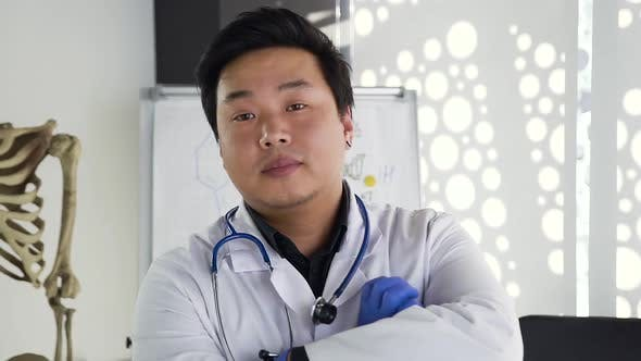 Thumbnail for Handsome Young High-Skilled Asian Doctor in white Gown and Stethoscope