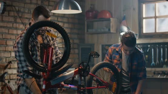 Cover Image for Father and Son Repairing a Bike in a Garage