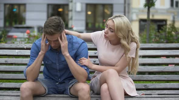 Thumbnail for Worried Guy Sitting on Bench, Girlfriend Calming Him Down, Problems, Support