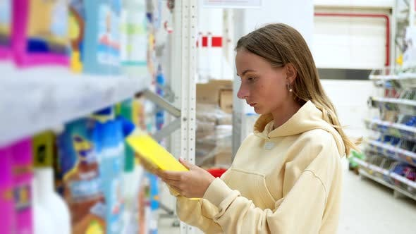 Thumbnail for Woman Choosing Detergent at a Household Goods in the Store