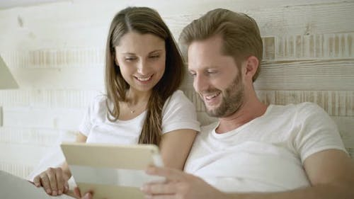 Couple With I Pad in Bed