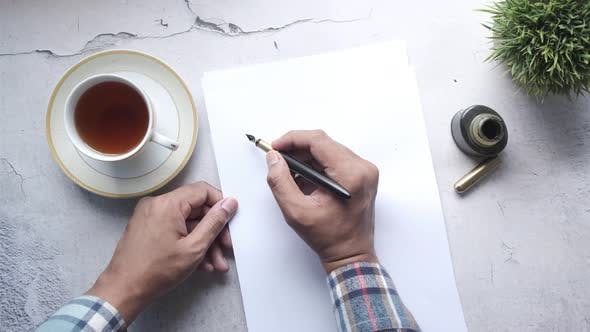 Man Hand Writing a Letter with Fountain Pen