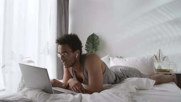 Thumbnail for Black Man in Glasses Working with Laptop
