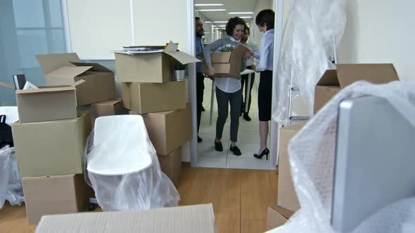 Thumbnail for Multi-Ethnic Business Team Bringing Stuff into New Office