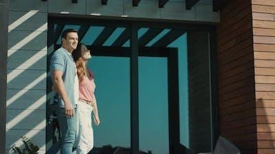 Couple Walking on Terrace. Beautiful Family Talking on Terrace in Slow Motion.