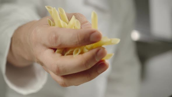 Thumbnail for Chief Pours Penne Rigate Pasta While Cooking