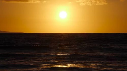 Big Red Hot Sun Above Ocean Horizon Sunset Over the Sea Big Rising Sun with Clouds