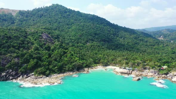 Thumbnail for Wide angle overhead travel shot of a sunshine white sandy paradise beach and blue ocean background i
