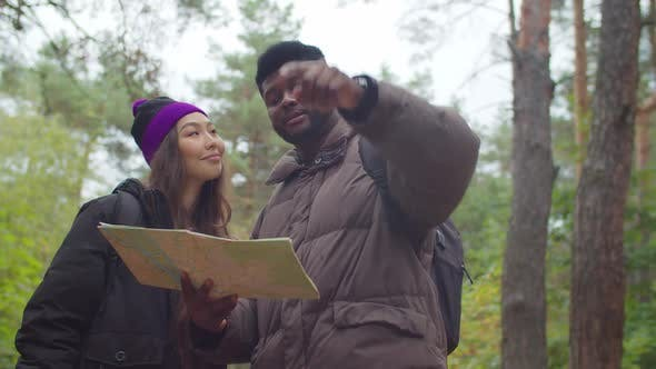 Thumbnail for Multiracial Tourists on Trek Navigating with Map