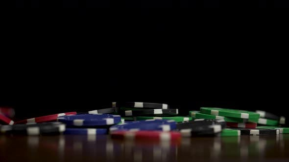 Thumbnail for Falling Poker Chips Isolated On Black Background