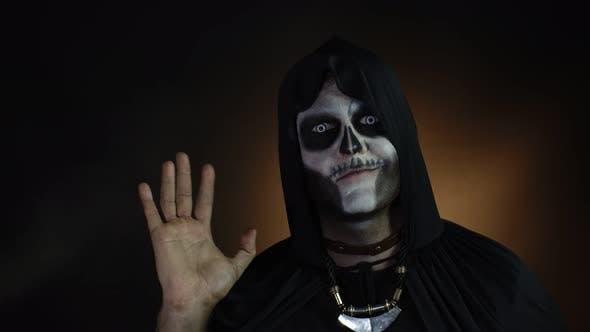 Thumbnail for Frightening Man in Skeleton Halloween Costume Waving Hands Looking at Camera. Hi, Hello, Greeting