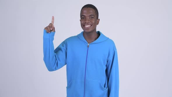 Thumbnail for Young Happy African Man Pointing Up