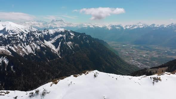 Thumbnail for Aerial Drone View on Snowy Peaks of Swiss Alps. Switzerland. Rochers-de-Naye Mountain Peak