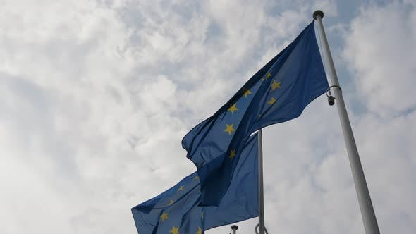 Thumbnail for Two EU Flags Fluttering in the Blue and White Air in Belgium in Spring in Slo-mo