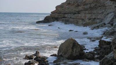 Waves Break on the Shore. Waves Break on the Rocks