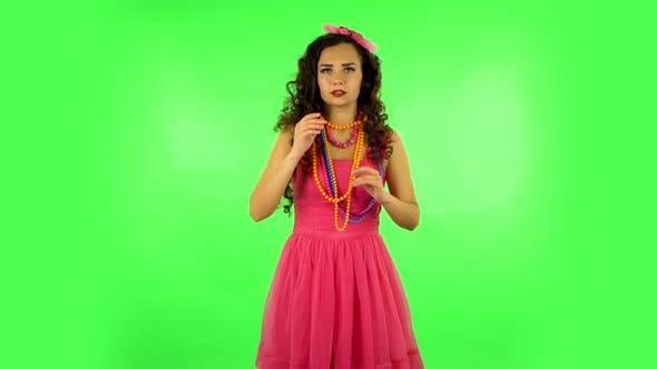 Thumbnail for Charming Girl Looks Around, Whispers the Secret and Making a Hush Gesture. Green Screen at Studio