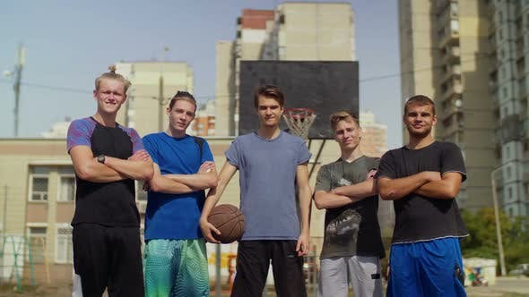 Thumbnail for Smiling Streetball Players with Basketball on Court