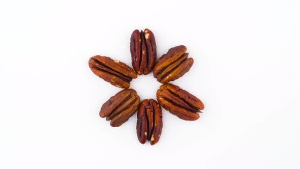 Thumbnail for Star Shaped Pecan Nuts Kernels. Rotating on the Turntable Isolated on the White Background