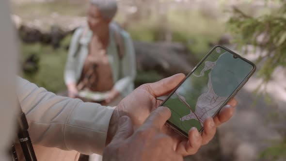 Hikers Using Cellphone for Navigation