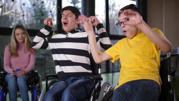 Thumbnail for Happy Disabled Boys Rejoicing Winning Bocce Game