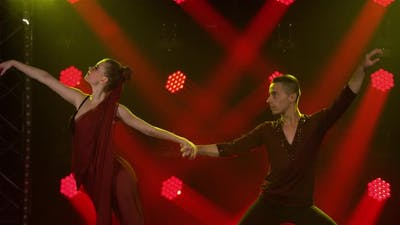 Young Couple of Dancers Dancing Ballroom Dance Elements