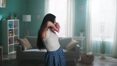 Woman Is Dancing In Living Room