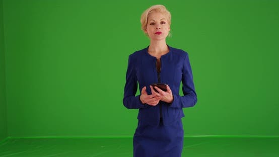 Thumbnail for Businesswoman looking at camera with serious expression on green screen