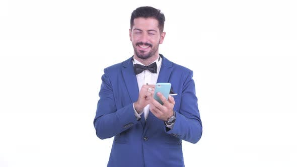 Thumbnail for Happy Young Bearded Businessman Talking on the Phone